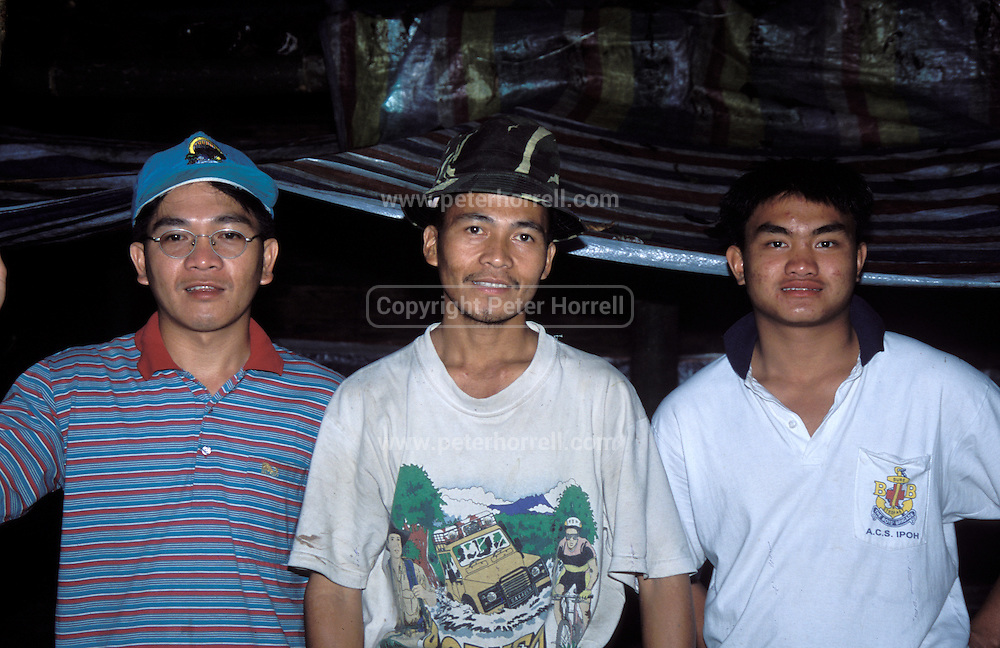 Sadib Miki (centre) is the owner of Miki Survival Camp. The camp is situated in the primary forest at the foothill of Mount Kinabalu called Mohan Tuhan.