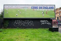 """© Licensed to London News Pictures; 11/07/2021; Bristol, UK. A giant billboard devised by Led By Donkeys is seen in the Old Market area of central Bristol, saying """"Come On England. PS. Real fans don't boo their team"""" on the day of the Euro 2020 Final between England and Italy. The billboard slogan is a reference to some booing that was heard at Euro matches re other teams and for football teams taking the knee in respect for Black Lives Matter. Photo credit: Simon Chapman/LNP."""