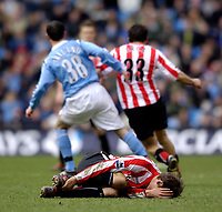 Photo: Jed Wee.<br /> Manchester City v Sunderland. The Barclays Premiership. 05/03/2006.<br /> <br /> Sunderland's Dean Whitehead lies injured as play goes on behind him.