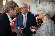 Lord  and Lady Sainsbury talk with their son at the 2010 Ashden Awards reception.