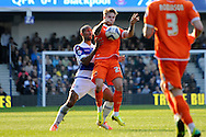 Blackpool's David Goodwilie © holds off  Queens Park Rangers Karl Henry. Skybet football league championship match , Queens Park Rangers v Blackpool at Loftus Road in London  on Saturday 29th March 2014.<br /> pic by John Fletcher, Andrew Orchard sports photography.