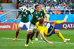 June 27, 2018 - Yekaterinburg, Russia - RAFAEL MARQUEZ of Mexico and MARCUS BERG  of Sweden collide during the FIFA World Cup group stage match between Mexico and Sweden in Yekaterinburg. Sweden won 3:0.  (Credit Image: © Petter Arvidson/Bildbyran via ZUMA Press)