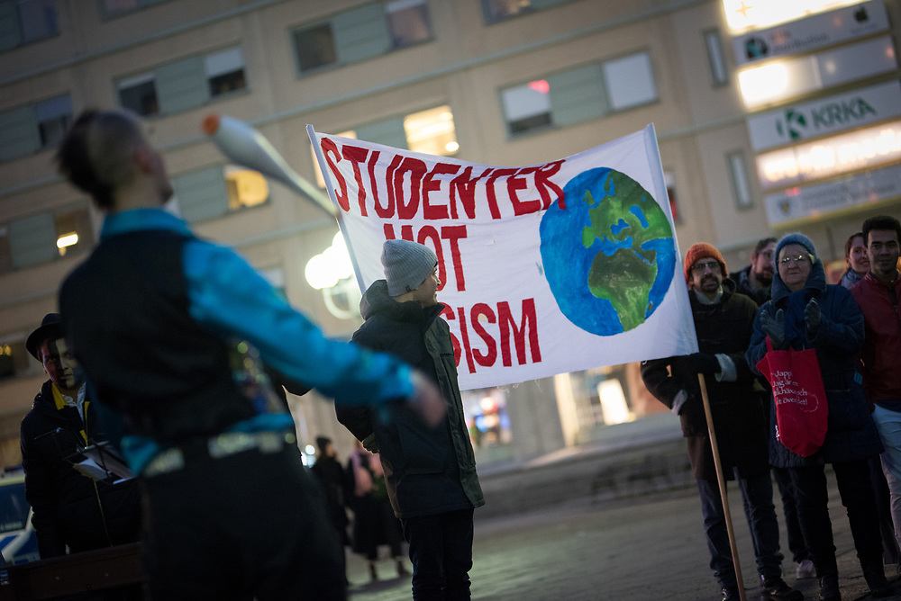 """25 November 2017, Stockholm, Sweden: """"Stop deporting people to a country that isn't safe"""", was the message as hundreds of people from all walks of life gathered at Medborgarplatsen in central Stockholm, to highlight Sweden's Refugee Day, and the way Swedish authorities keep persisting in deporting young people to Afghanistan. The event marked two years since November 2015, when Swedish government officials took a turn towards stricter policies for granting refugee status to asylum seekers, and so a range of civil society organizations, including faith-based organizations, now take a stand for more humane refugee policies. Here, a banner from Studenter mot Rasism ('Students against Racism"""")."""