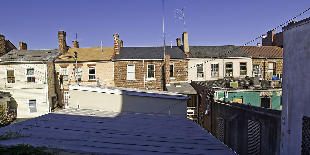 Row house rooftops from an alley in Fredericksburg, VA.