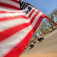 051514  Adron Gardner/Independent<br /> <br /> An American flag flaps in the wind during the arrival of motorcycles participating in Run for the Wall at Red Rock Park Thursday.