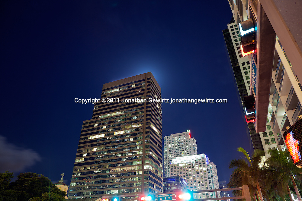 Night view of condo and office buildings, looking south along Miami's Brickell Avenue, one of its main commercial and residential thoroughfares.