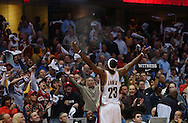LeBron James plays to the crowd at Quicken Loans Arena before Game 4 of the Eastern Conference Playoffs May 15, 2006 against Detroit. The Cavaliers won the game to tie the series at two wins apiece.