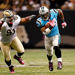 October 3, 2010; New Orleans, LA, USA; Carolina Panthers running back DeAngelo Williams (34) runs away from New Orleans Saints defensive end Will Smith (91) on a touchdown run during the third quarter at the Louisiana Superdome. Mandatory Credit: Derick E. Hingle