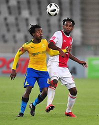 Cape Town 180109 Ajax Cape Town captain Mosa Lebusa and Percy tau of Mamelodi Sundowns clash for a high ball  in the PSL match at Cape Town Stadium. Even though Ajax were leading,sundowns came back strong to finish the game 2-1 with goals from Rocardo Nascimento and Sibusiso Vilakazi. Picture:Phando Jikelo/African News Agency(ANA)