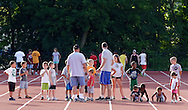 Children get ready for the start of a race during the Twilight Track Series at Middletown High School on Tuesday, July 30, 2013.