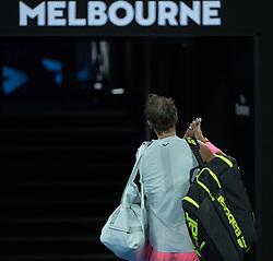 MELBOURNE, Jan. 23, 2018  Spain's Rafael Nadal leaves the court after the men's singles quarterfinal against Croatia's Marin Cilic at Australian Open 2018 in Melbourne, Australia, Jan. 23, 2018. Rafael Nadal retired with injury in quarterfinal. (Credit Image: © Zhu Hongye/Xinhua via ZUMA Wire)