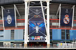 Police patrol the walkways outside the ground prior to a press conference held at the National Stadium in Wales ahead of tomorrow's UEFA Champions League Final against Real Madrid