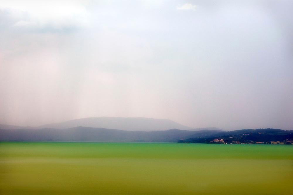 Distant storm at Lake Trasimeno, Italy