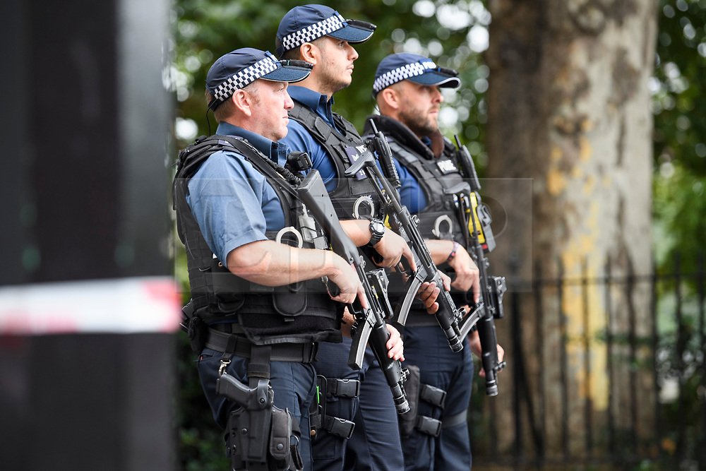 © Licensed to London News Pictures. 14/08/2018. London, UK. Armed police stand at a police cordon near where a car rammed the security barriers at the Houses of Parliament in London. It has been reported that pedestrians were hit by the car. Photo credit: Ben Cawthra/LNP