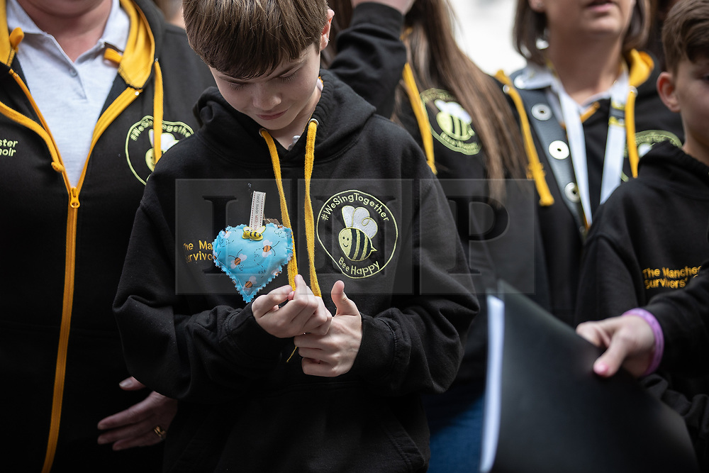 © Licensed to London News Pictures . 22/05/2019. Manchester, UK . The Manchester Survivors Choir sing in St Ann's Square in Manchester City Centre on the second anniversary of the Manchester Arena bombing following a private service in St Ann's Church . On the evening of 22nd May 2017 , Salman Abedi murdered 22 people and seriously injured dozens more , when he exploded a bomb in the foyer of the Manchester Arena as concert-goers were leaving an Ariana Grande gig . Photo credit: Joel Goodman/LNP