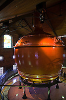 Giant copper wort kettle at Sapporo Brewery's Beer Museum.  As part of the brewing process, malt juice or wort is cooked in a wort kettle.  By adding hops in to the kettle, the desired bitterness and aroma are created.