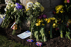 Floral tributes and pebbles painted with a Union Jack design left by members of the public outside the Cambridge Gate to Windsor Castle are pictured on the eve of the funeral of the Duke of Edinburgh on 16th April 2021 in Windsor, United Kingdom. The funeral of Prince Philip, Queen Elizabeth II's husband, will take place at St George's Chapel in Windsor Castle at 15:00 BST on 17th April, with the ceremony restricted to 30 mourners in accordance with current coronavirus restrictions.