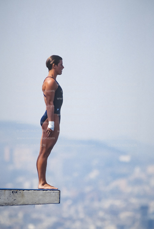 BARCELONA - JULY 27:  Mary Ellen Clark of the United States, the eventual bronze medalist, competes in the Women's 10 meter Diving final at the Piscina Municipal de Montjuic on July 27, 1992 during the Summer Olympics in Barcelona, Spain.  (Photo by David Madison/Getty Images)