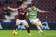 Gary Mackay-Steven (#11) of Heart of Midlothian FC shields the ball from Anthony Ralston (#56) of Celtic FC during the Cinch SPFL Premiership match between Heart of Midlothian FC and Celtic FC at Tynecastle Park, Edinburgh, Scotland on 31 July 2021.