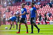 Sam Smith of Shrewsbury Town (17) and Josh Laurent of Shrewsbury Town (28) warming up during the EFL Sky Bet League 1 match between Barnsley and Shrewsbury Town at Oakwell, Barnsley, England on 19 April 2019.
