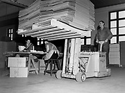 Fort lift truck carrying cardboard boxes in a paper factory, Finland 1950s-1960