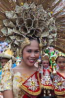 Sinulog Queen with Santo Nino - Sinulog is an annual festival held on the third Sunday of January in Cebu, the  Philippines. The festival honors  Santo Niño - the patron Saint of  Cebu. The festival takes several days with beauty pageants, contests, and street dances that commemorates the local peoples origins and their acceptance of Roman Catholicism after the arrival of Magellan.