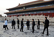 Band musicians walks to a corporate event held at the imperial ancestral temple, or Tai Miao, next to the forbidden palace in Beijing, China on 23 August 2012.