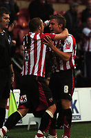 Photo: Tony Oudot.<br /> Brentford v Lincoln City. Coca Cola League 2. 27/10/2007.<br /> Sammy Moore of Brentford celebrates his winning goal with team mate Craig Pead