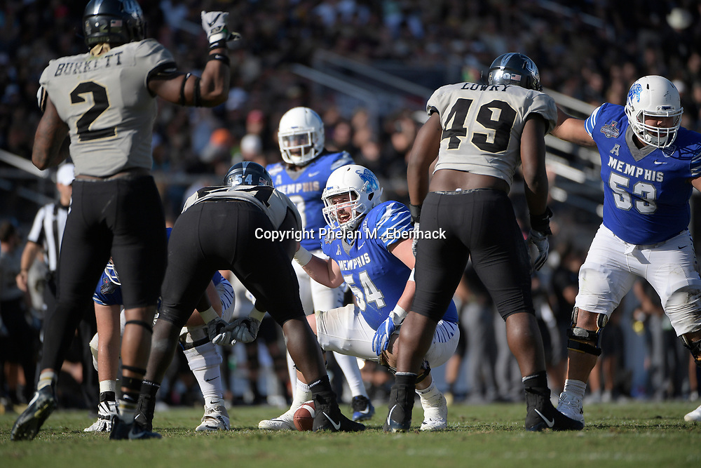 Memphis offensive lineman Drew Kyser (54) sets up for a play during the second half of the American Athletic Conference championship NCAA college football game against Central Florida Saturday, Dec. 2, 2017, in Orlando, Fla. Central Florida won 62-55. (Photo by Phelan M. Ebenhack)