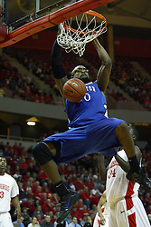 29 December 2010: All alone, Gregory Echenique looks at the hoop and smashes a dunk during an NCAA basketball game where the Creighton Bluejays defeated the Illinois State Redbirds at Redbird Arena in Normal Illinois.