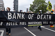 Protesters with a 'Bank of Death' banner at Extinction Rebellion demonstration on 3rd September 2020 in London, United Kingdom. With government resitting after summer recess, the climate action group has organised two weeks of events, protest and disruption across the capital. Extinction Rebellion is a climate change group started in 2018 and has gained a huge following of people committed to peaceful protests. These protests are highlighting that the government is not doing enough to avoid catastrophic climate change and to demand the government take radical action to save the planet.
