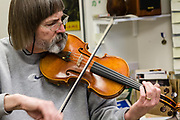 Beekman trying out a newly strung bow.