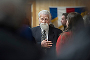 """U.S. Navy veteran Harland Draper holds his hand over his heart for the Pledge of Allegiance on Monday, Nov. 11, 2019 in a Veterans Day commemoration at American Legion Post 3 in Ketchikan, Alaska. Draper was presented with a Quilt of Valor at the event. November 11 marks the day that hostilities of World War I were ended and the Armistice of 11 November 1918 was signed in a railway carriage near Compiegne, France. In 1940 during World War II, Nazi Party leader Adolf Hitler snaffled the carriage, which is known as the """"Compiegne Wagon,"""" from a French museum, and used it to sign the Second Armistice with the French in the same location."""