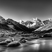 Kangtega and other peaks of the upper Khumbu Himalaya rise above the Tsola River in the village of Pheriche, Solu-Khumbu region, Nepal.