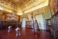 Third Room of The Library. Queen Mary Caroline commissioned  German painter Freidrich Heinrich Fuger to decorate the Third Library Room. The paintings on the wall represent classical themes of: The Parnassus with Apollo and the Three Graces, The Envy and the Richness, The School of Athens, The protection of The Arts. The two globes represent the planisphere and the astral map and were donated to Ferdinand IV of Bourbon by King of France Louis XVI, his brother-in-law. The Kings of Naples Royal Palace of Caserta, Italy. A UNESCO World Heritage Site .<br /> <br /> Visit our ITALY HISTORIC PLACES PHOTO COLLECTION for more   photos of Italy to download or buy as prints https://funkystock.photoshelter.com/gallery-collection/2b-Pictures-Images-of-Italy-Photos-of-Italian-Historic-Landmark-Sites/C0000qxA2zGFjd_k<br /> <br /> <br /> Visit our EARLY MODERN ERA HISTORICAL PLACES PHOTO COLLECTIONS for more photos to buy as wall art prints https://funkystock.photoshelter.com/gallery-collection/Modern-Era-Historic-Places-Art-Artefact-Antiquities-Picture-Images-of/C00002pOjgcLacqI