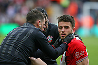 Football - 2017 / 2018 Premier League - Southampton vs. AFC Bournemouth<br /> <br /> The medical team check over Southampton's Wesley Hoedt  after the player took a whack to his neck at St Mary's Stadium Southampton<br /> <br /> COLORSPORT/SHAUN BOGGUST