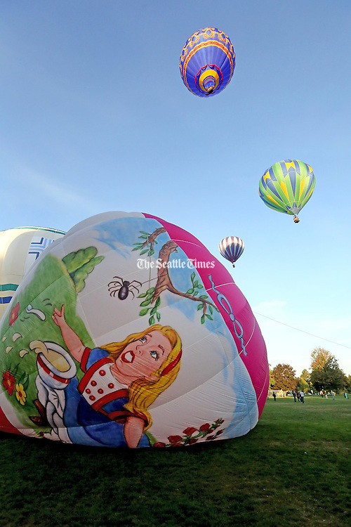 A hot air balloon with a hand painted portrait on the ground at the 41st annual Balloon Stampede.  <br /> <br /> Greg Gilbert / The Seattle Times
