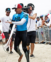 HUNTINGTON BEACH, California/USA (Sunday,Aug 7, 2011) 10-Time ASP World Champion Kelly Slater (Cocoa Beach, FL), 39, returns to the athlete's compound after defeating Dusty Payne at the semifinals sunday afternoon at the U.S. Open of Surfing 2011. Photo: Eduardo E. Silva.