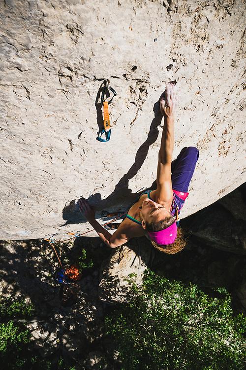 Alli Rainey works Last Man Standing, 5.13a, Wild Iris, Wyoming.