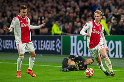10-04-2019 NED: Champions League AFC Ajax - Juventus,  Amsterdam<br /> Round of 8, 1st leg / Ajax plays the first match 1-1 against Juventus during the UEFA Champions League first leg quarter-final football match / Frenkie de Jong #21 of Ajax, Federico Bernardeschi #33 of Juventus, Nicolas Tagliafico #31 of Ajax