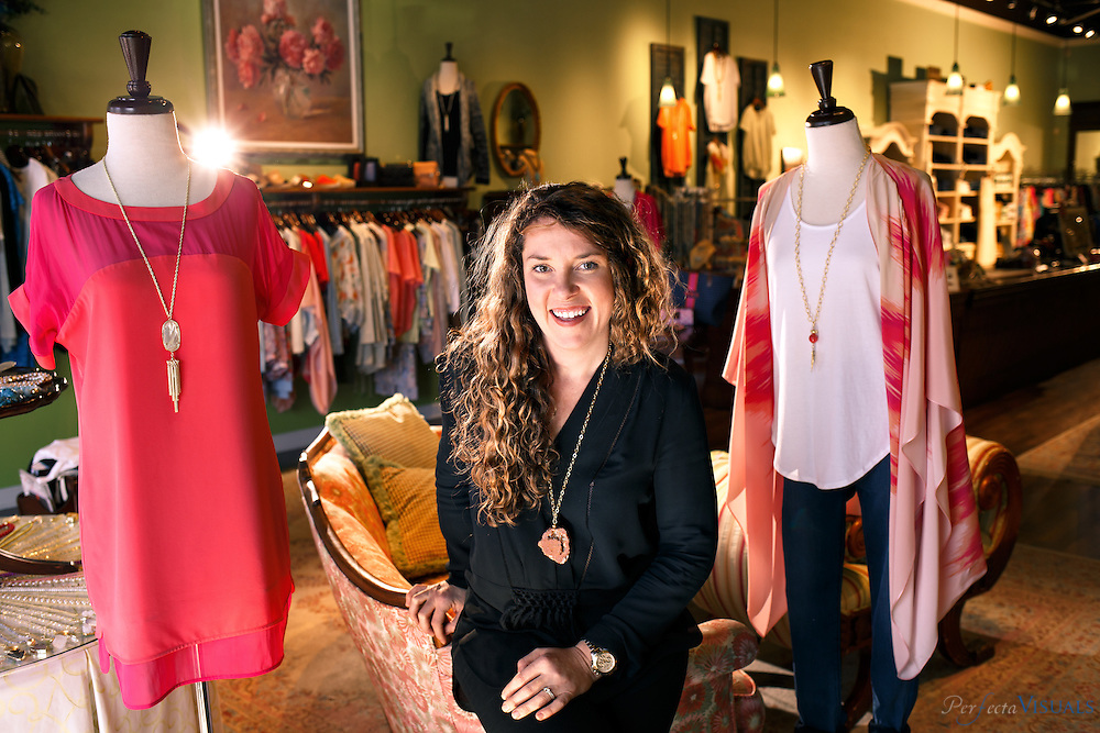 Sarah Doggett Evenson at Simply Meg's, a <br /> boutique store at Friendly Center Shopping Mall where her clothing is sold. Sarah is the founder and creative director of Marie Oliver, a clothing line featured in 100 stores across the south and southeast.A Greensboro native, she earned a business degree from Elon University prior to creating her company.