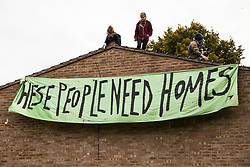 A banner is dropped by housing activists occupying a rooftop on the Sweets Way housing estate close to the home of its last surviving resident, Mostafa Aliverdipour, on 23rd September 2015 in London, United Kingdom. A group of housing activists calling for better social housing provision in London had occupied some of the properties on the 142-home estate in Whetstone, in some cases refurbishing properties intentionally destroyed by the legal owners following eviction of the original residents, in order to try to prevent or delay the eviction of Mr Aliverdipour and the planned demolition and redevelopment of the entire estate by Barnet Council and Annington Property Ltd.