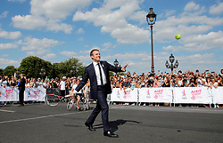 French President Emmanuel Macron plays tennis on the Pont Alexandre III in Paris, France, June 24, 2017. The French capital is transformed into a giant Olympic park to celebrate International Olympic Days with a variety of sporting events for the public across the city during two days as the city bids to host the 2024 Olympic and Paralympic Games. Photo by Jean-Paul Pelissier/Pool/ABACAPRESS.COM