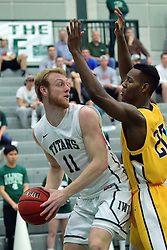 21 February 2017:  Colin Bonnett trapped by Chrishawn Orange during an College men's division 3 CCIW basketball game between the Augustana Vikings and the Illinois Wesleyan Titans in Shirk Center, Bloomington IL