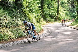 Lotta Lepistö leads down a twisting descent through the forests at Boels Hills Classic 2016. A 131km road race from Sittard to Berg en Terblijt, Netherlands on 27th May 2016.