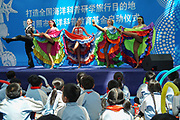 Burlesque dancing with frilly skirts showing legs and all that, to an audience of children inside Rizhao Ocean Park, Marina, during opening ceremonies, Shandong Province