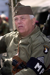 """A reenactor portrays a sergeant from the American 101st Airborne """"Screaming Eagles"""" armed with a Colt 45 Automatic Pistol carried in a shoulder holster and wearing an MP (Military Police) Armband  <br /> 4 September 2009  Copyright Paul David Drabble"""