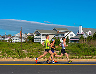 Spring Lake, NJ USA -- May 27, 2017  Three competitors in the annual Spring Lake 5 mile race sprint down Ocean Avenue.   Editorial Use Only.