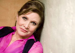 CARRIE FRANCES FISHER (October 21, 1956 - December 27, 2016) the actress best known as Star Wars' Princess Leia Organa, has died after suffering a heart attack. She was 60. Pictured: October 9, 2012 - Beverly Hills, CA, USA - Actress Carrie Fisher poses during an interview at her home in Coldwater Canyon in 2012. (Credit Image: © Leonard Ortiz/The Orange County Register via ZUMA Wire)