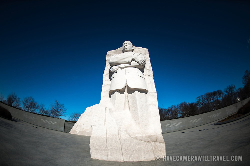 The Martin Luther King Jr Memorial against a clear blue sky next to the Tidal Basin in Washington DC.